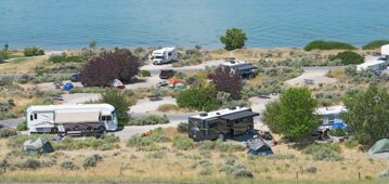 RVs and Campers at a lake