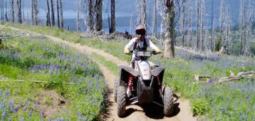 person on ATV on a trail