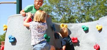 kids climbing on playground equipment