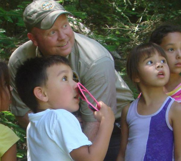 park ranger pictured with 4 kids