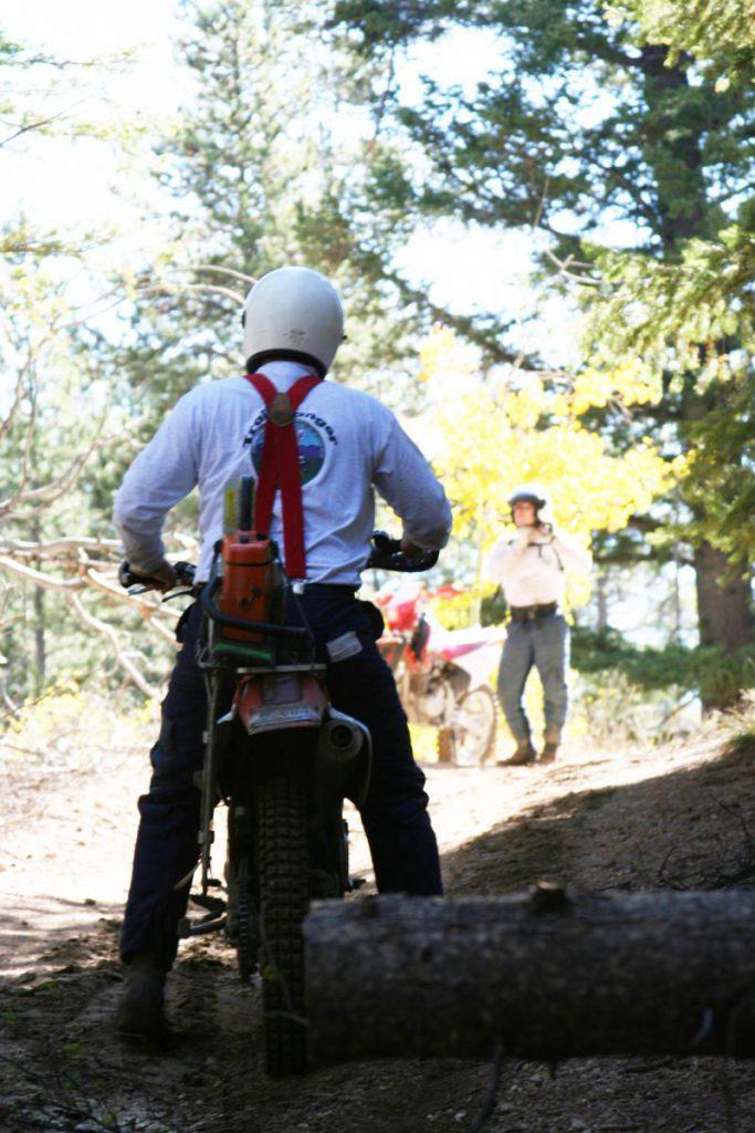 ranger on dirtbike on trail