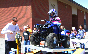kids on atvs with trophy