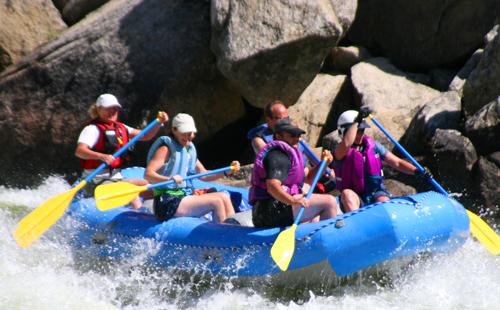 people on water water raft