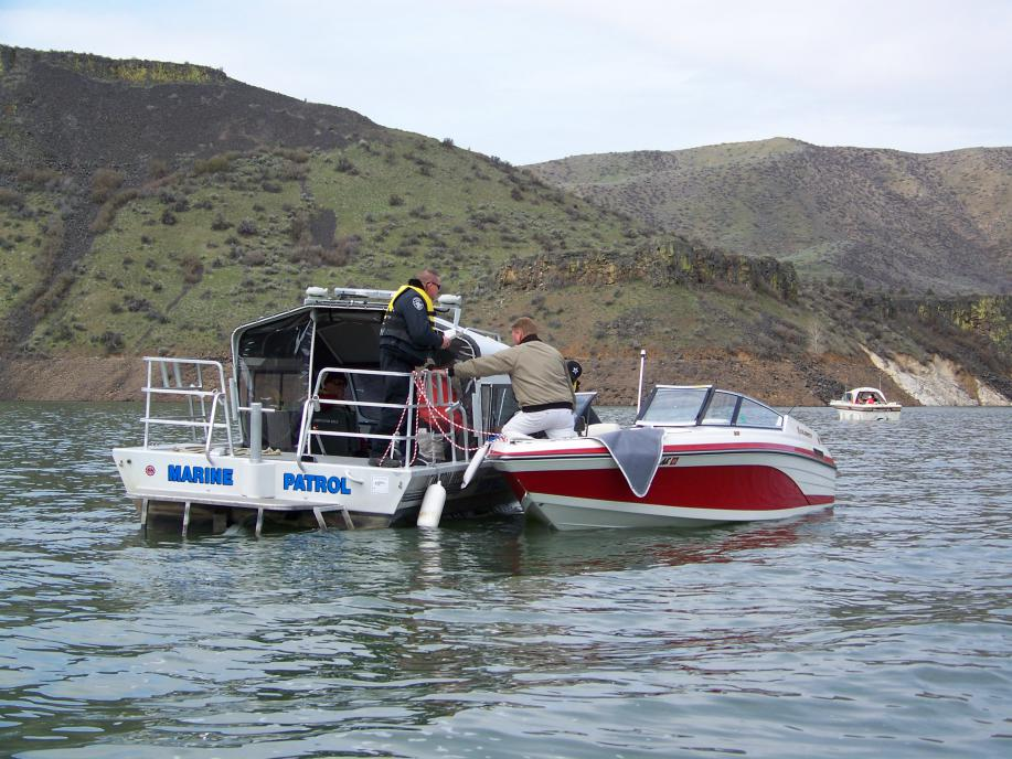 boat law enforcement pulling over a boat