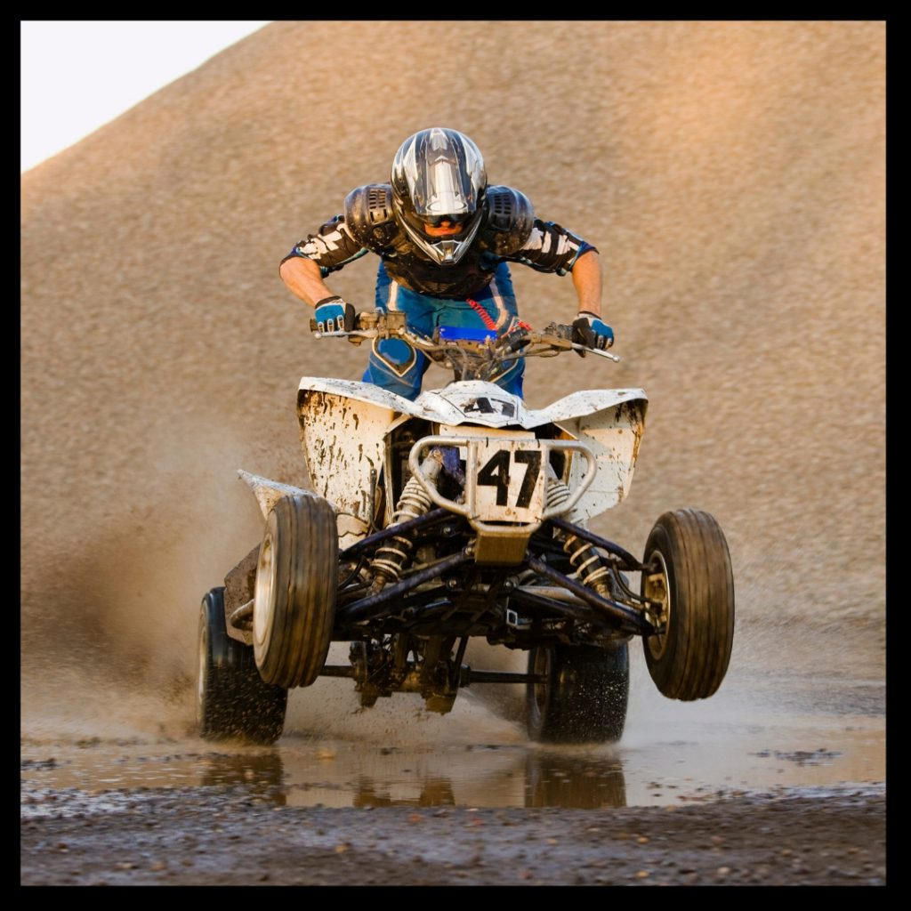 ATV racer on sand